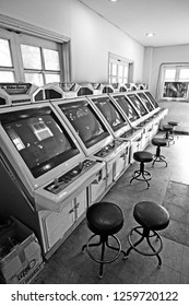 Daejeon, South Korea - July 2, 2011: A video game arcade filled with vintage gaming machines at the site of the 1993 Expo in Daejeon, South Korea. Suitable to illustrate obsolete or retro technology.