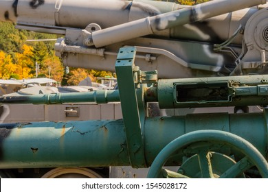 Daejeon, South Korea; October 27, 2019: 50 caliber spotting rifle mounted on top of M40 recoilless gun mounted on Willys M38A1 military jeep on display in National Cemetery.
