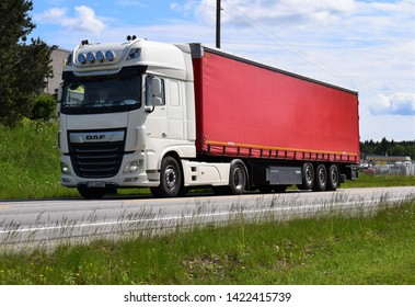 DAF truck vehicle on the road transporting goods for delivery - sunny and summer season - Kongsvinger, Norway (11th june 2019)
