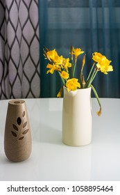 Daffodils in a vase on a table