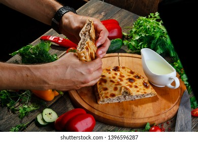 dagestan meat pie on a wooden background. Dagestan chudu with meat and serum