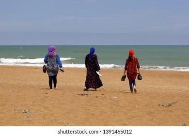 Dagestan/Russia - 08.10.2016: three women go to the sea