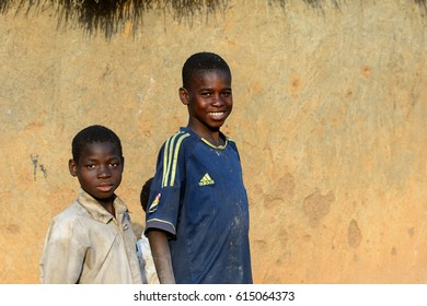 DAGOMBA VILLAGE, GHANA - JAN 14, 2017: Unidentified Dagomban boy in blue shirt smiles in the local village. Dagombas are ethnic group of Northern Ghana
