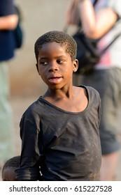 DAGOMBA VILLAGE, GHANA - JAN 14, 2017: Unidentified Dagomban in black shirt looks away in the local village. Dagombas are ethnic group of Northern Ghana