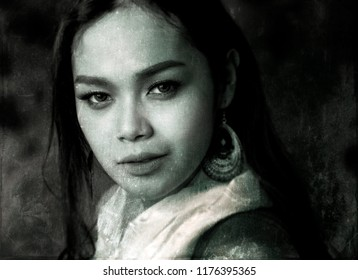 Daguerreotype styled black and white studio portrait of a transgender Thai model wearing a white scarf