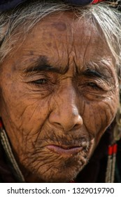 Dah Hanu, Ladakh / India - June 29 2014: In the cold desolate desert region of the Himalayas. Along the azure Indus river valley, live the Brokpa tribe (floral headgear), descendants of Aryan race