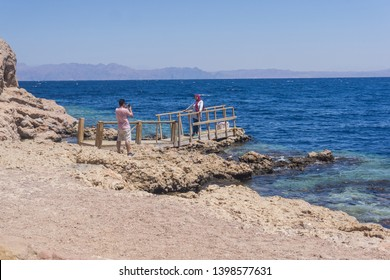 Dahab city , South Sinai , Egypt - January 11th 2018  people taking pictures in that amazing beach around Dahab in South sinai , this amazing beach in the red sea surrounded by mountains and desert.