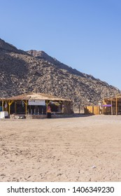 Dahab city , South Sinai , Egypt - January 11th 2018  Huts made of palm on this beautiful beach around Dahab in South sinai , this amazing beach in the red sea surrounded by mountains and desert.