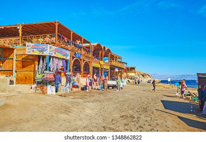 DAHAB, EGYPT - DECEMBER 16, 2017: The small tourist bazaar  with sport equipment, souvenirs and foods, located in in Blue Hole snorkeling spot, on December 16 in Dahab.