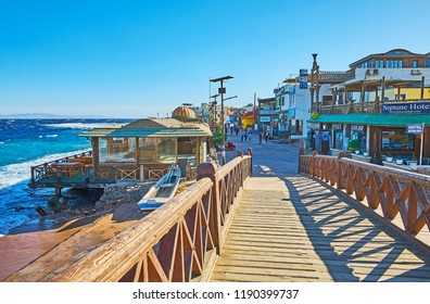 DAHAB, EGYPT - DECEMBER 25, 2017: Walk the seaside promenade, occupied with tourist shops, coastal cafes and hotels, on December 25 in Dahab.