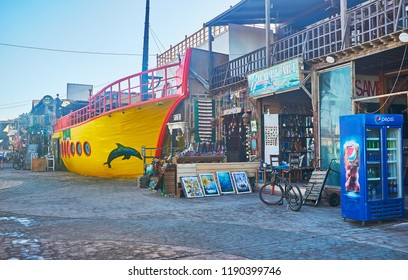 DAHAB, EGYPT - DECEMBER 25, 2017: The bright yellow ship in shopping street attracts tourists to visit this unusual cafe, on December 25 in Dahab.