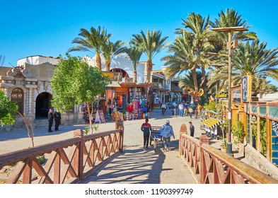 DAHAB, EGYPT - DECEMBER 25, 2017: The tourist street of resort stretches along the shore of Aqaba gulf and boasts numerous stores and restaurants, on December 25 in Dahab.