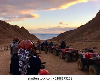 Dahab / Egypt - January 1, 2018: People on quad bikes in desert