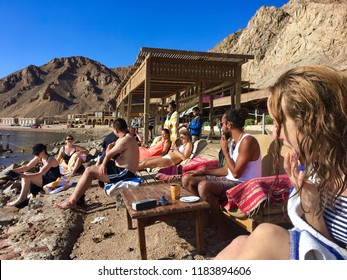 Dahab/ Egypt - January 2 2018: Tourists relaxing on the beach after snorkeling at the Blue Hole in Dahab, Egypt