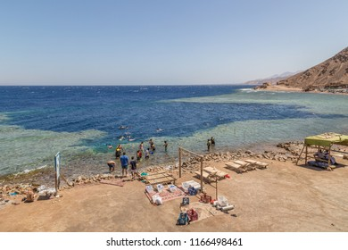 DAHAB, EGYPT - JUNE 22, 2014: The tourists are on vacation at Red sea. Beautiful coast of the Red Sea in the city of Dahab, Egypt, Africa