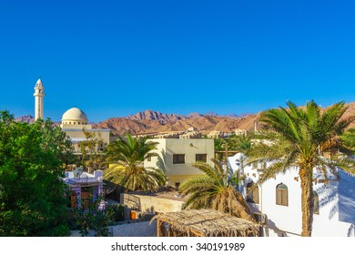 Dahab, Sinai Peninsula, Egypt, View of the mosque and the houses at the foot of Mountains Sinai
