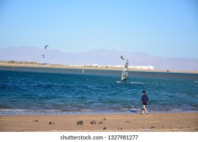 Dahab/Egypt - 30/12/2018 - Wdinsurfing in Dahab , with mountains in background and clear beach water in sunny day , Blue lagoon , abo ghaloom , three pools