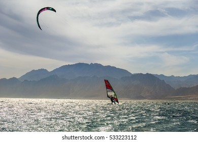 DAHAB.EGYPT - March 04 ,2015 : a kite and windsurf  in the Red sea against the backdrop of the Sinai Mountains