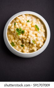 Dahi Bundi or Boondi Raita with curd, is a Popular side dish from Rajasthan, India. Served with coriander toppings in a bowl over colourful or wooden background. Selective focus