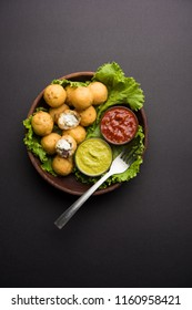 Dahi Ke Angare or kebab is a popular snack item from India / Pakistan. served with green and red sauce. Selective focus