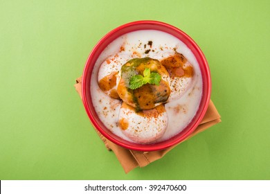 Dahi Vada or Dahi Bhalla also known as Curd Vadai in South India, Popular throughout India. Prepared by soaking lentil vadas in thick dahi or yogurt, topped with spicy & sweet chutney, selective focus