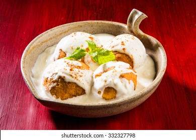 Dahi Vada or Bhalla is a popular snack in India. It is prepared by soaking vadas in thick dahi/curd. Served with tamarind/imli chutney, selective focus