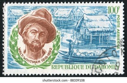 DAHOMEY - CIRCA 1970: stamp printed by Dahomey, shows Walt Whitman and Dahoman Huts, circa 1970