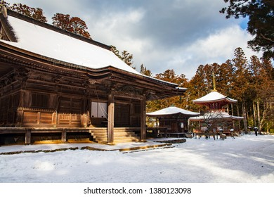 Daiedo hall (Rengejoin) in Danjo Garan complex, Sanmaido Hall and Toto Pagoda in the background, covered with snow on a sunny day, Koyasan, UNESCO World Heritage area, Wakayama prefecture, Japan