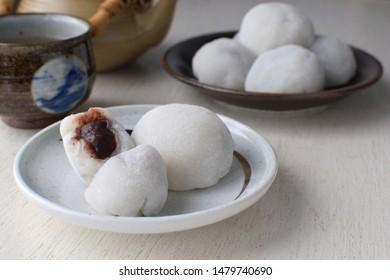 Daifuku japanese desserts on white plate and wood table.
