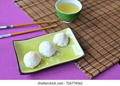 Daifuku mochi  (glutinous rice cakes) filled with fresh mango