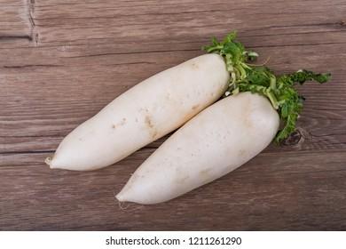 Daikon radish on the wood background