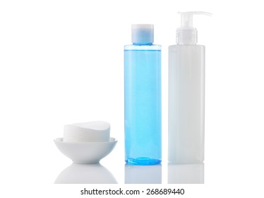 Daily cleansing cosmetics - face wash cleansing gel, smoothing toner and cotton cleansing pads isolated on white background.