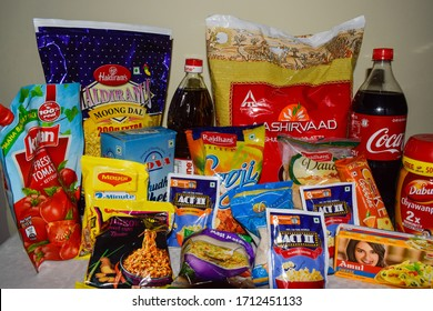 Daily grocery products kept on display for sale.The food items are from multiple FMCG brands. Packaged food products like flour, noodles, Popcorn, Cheese Ketchup, Savory and areated drinks can be seen
