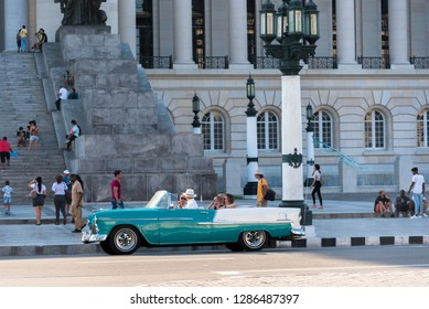 Daily life between tourists and locals in a street in Old Havana in front of the Capitol of Havana. Havana Cuba January 2, 2019