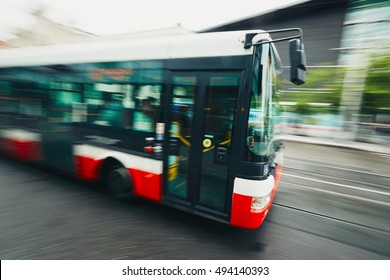 Daily life in the city. Bus of the public transport on the street - blurred motion