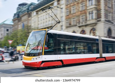 Daily life in the city. Modern tram of public transportation in blurred motion. Traffic at Wenceslas Square, Prague, Czech Republic.