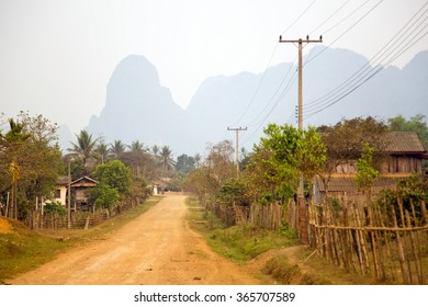 Daily life of Vang Vieng village with limestone mountains, Laos