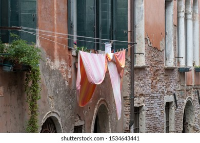Daily life of Venice. Linen is drying outside the windows. Italy.