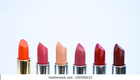 Daily make up. High quality lipstick. Cosmetics artistry. Lipstick for professional make up. Pick color which suits you. Compare makeup products. Lip care concept. Lipsticks on white background.