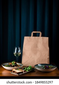 daily meals and snacks. Diet nutrition and brown paper bag package with copy space, Healthy food delivery from a restaurant, delicious food on the background of a paper bag package