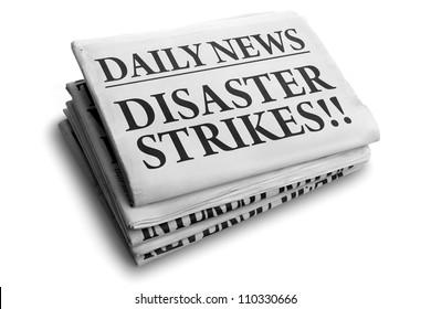 Daily news newspaper headline reading disaster strikes