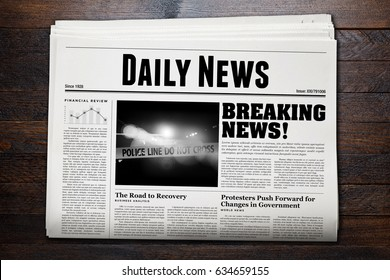 Daily Newspaper with wooden background.