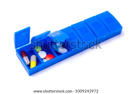 Daily pill box with doses of tablets for each day or in turn isolated on a white background