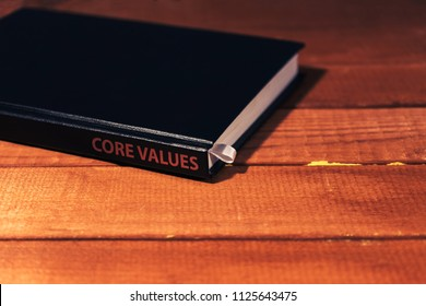 Daily planner on a red wooden table. CORE VALUES CONCEPT