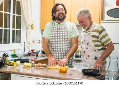 daily scene for two man father and son family preparing dinner at home. men at work concept doinga a cake in the kitchen. smile and enjoy the life at home.