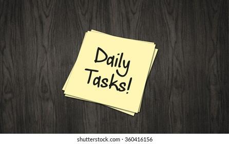 Daily Tasks written in handwriting on paper slip