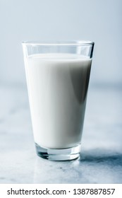 Dairy, healthy nutrition and breakfast concept - World Milk Day, full glass on marble table