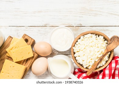 Dairy product at white wooden table.