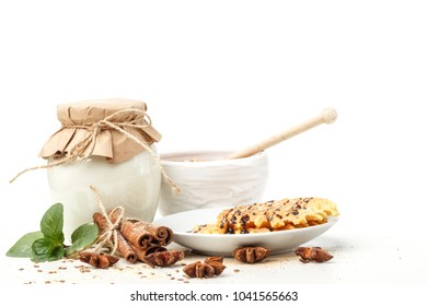 Dairy products with anise and cinnamon on a white background. Healthy eating. Isolated.