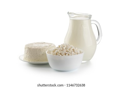 Dairy products. Bowl of cottage cheese and milk isolated on white background